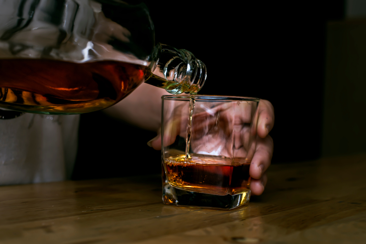 Pouring whiskey in glasses