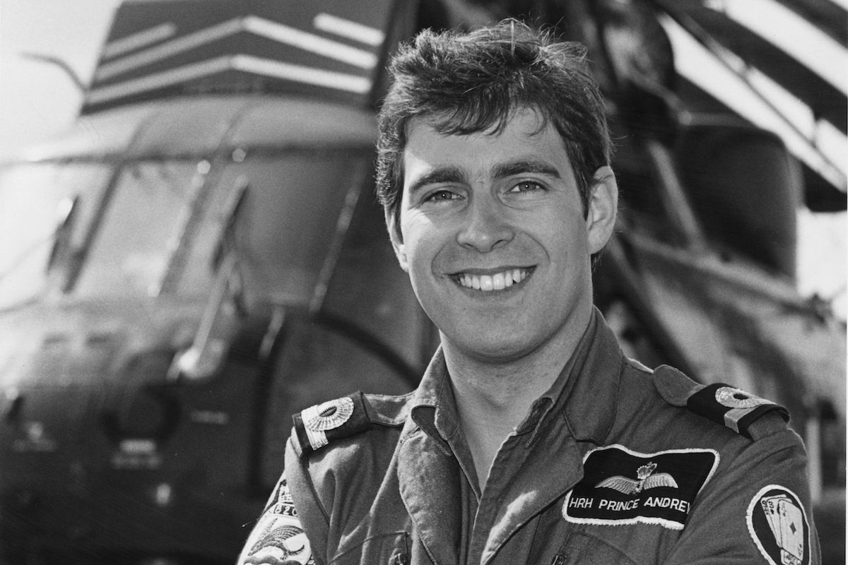 Andrew, Duke of York standing by a Royal Air Force helicopter, circa 1981
