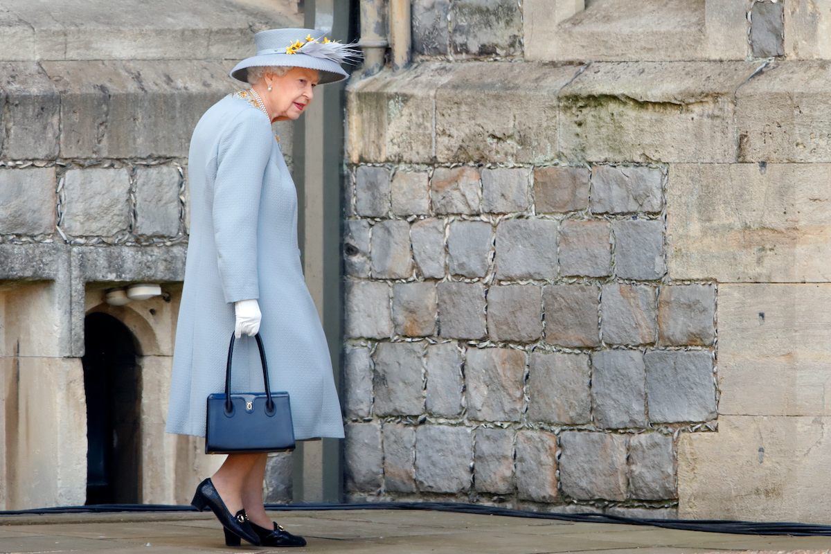 Queen Elizabeth II attends a military parade, held by the Household Division (during which The Queen's Colour of F Company Scots Guards will be trooped) in the Quadrangle of Windsor Castle, to mark her Official Birthday on June 12, 2021 in Windsor, England.