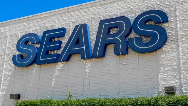 Fairview Heights, IL—June 1, 2018; Sears department store sign on the side of mall. Sears is a national retailer with more than 500 locations in the United States