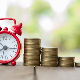 Retirement time line with clock and stacks of coins
