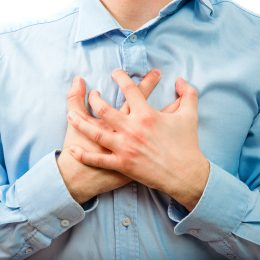 Man holding his hands over heart