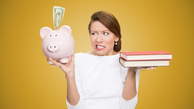 Cost,Of,College,Education.,Portrait,Stressed,Woman,Balancing,Piggy,Bank