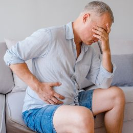 Older man with stomach pain