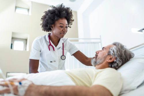 Doctor comforting elderly patient in hospital bed or counsel diagnosis health.
