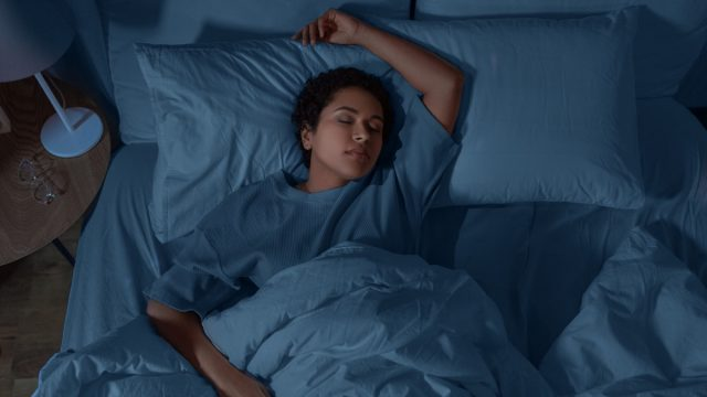 woman sleeping in bed at home at night