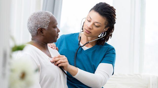 Female home healthcare providers checks patient's vital signs