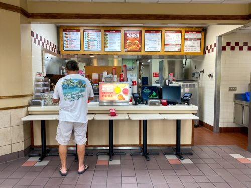 Orlando, FL/USA - 6/5/20: A Wendy's interior with social distancing information on the tables.