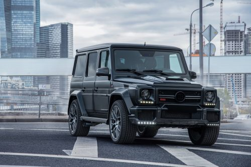 a 2018 Mercedes Benz G Class in front of a building