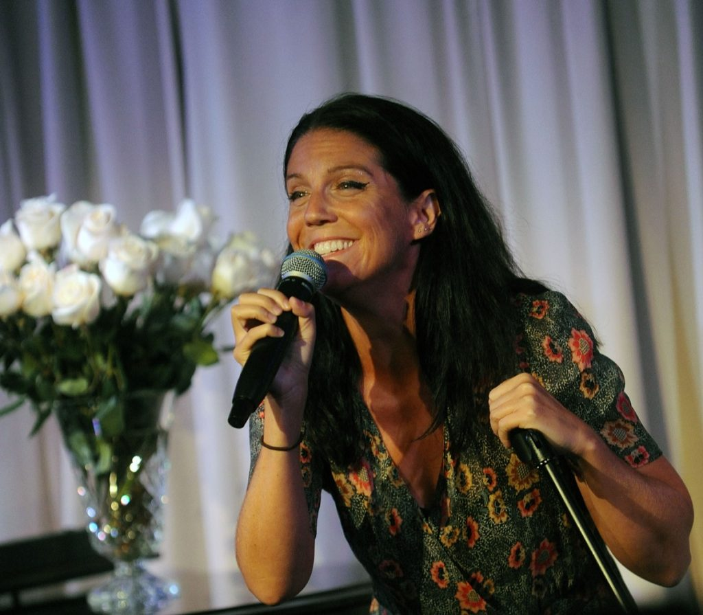 AJ Lambert singing into microphone