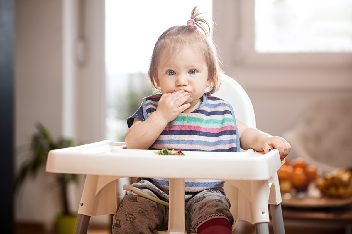 Baby in highchair with hiccups