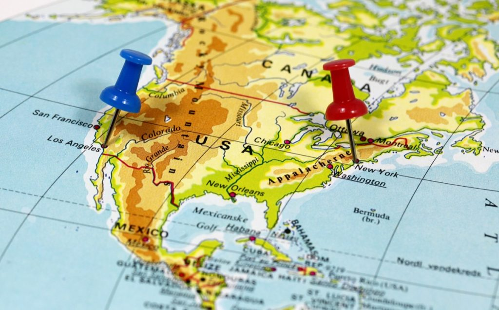 Map of American with thumb tacks in California and New York