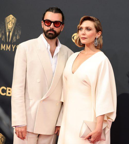 Elizabeth Olsen and husband Robbie Arnett at the 2021 Emmys