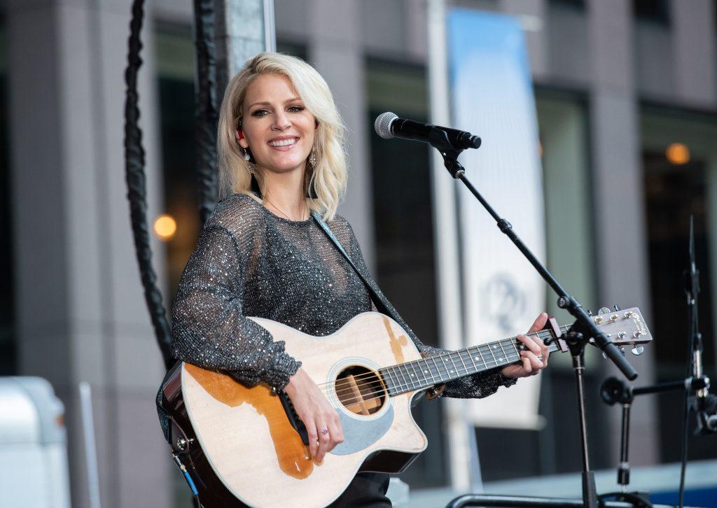 Jennifer Wayne with guitar