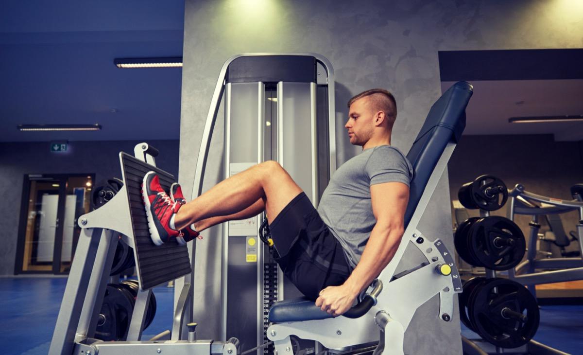 Man using leg press at gym