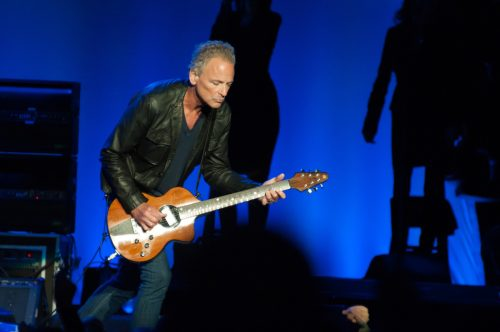 Lindsey Buckingham performing with Fleetwood Mac in July 2013