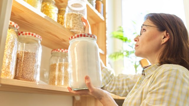 Lady inspecting pantry items