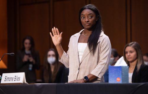 Simone Biles being sworn in to testify during a Senate Judiciary hearing regarding the FBI's investigation of Larry Nassar on September 15, 2021