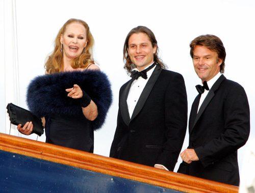 Ursula Andress, Dimitri Hamlin, and Harry Hamlin at her 70th birthday party in May 2006