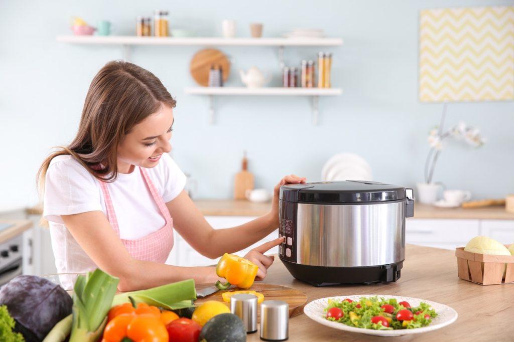 Woman using multi cooker