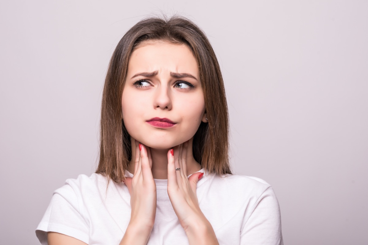 Woman with sore tonsils