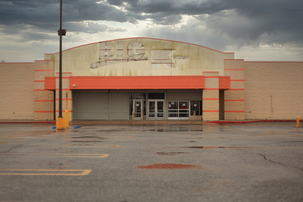 A closed Kmart location with the signage removed