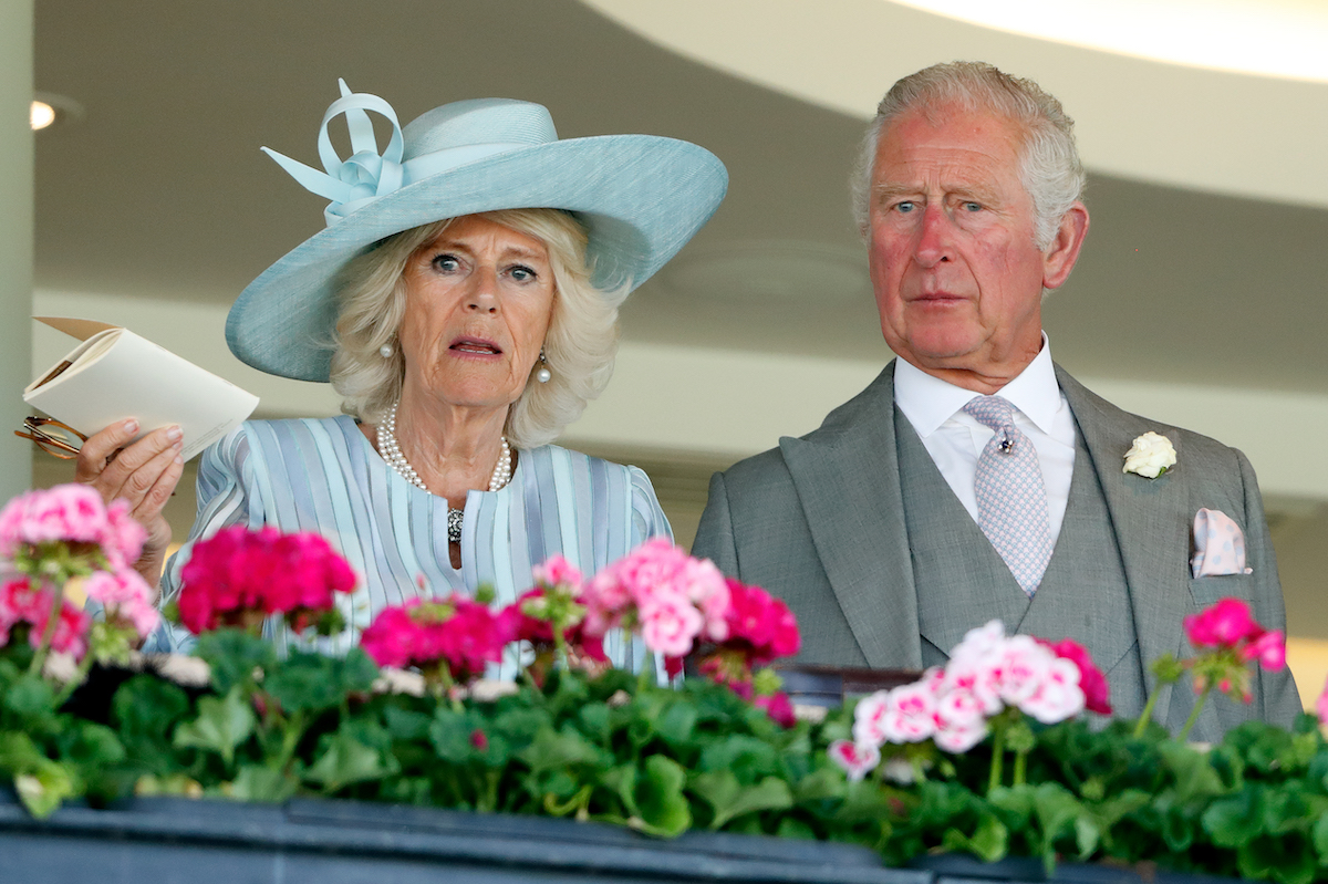 Camilla, Duchess of Cornwall and Prince Charles, Prince of Wales watch the racing as they attend day 1 of Royal Ascot at Ascot Racecourse on June 15, 2021 in Ascot, England.