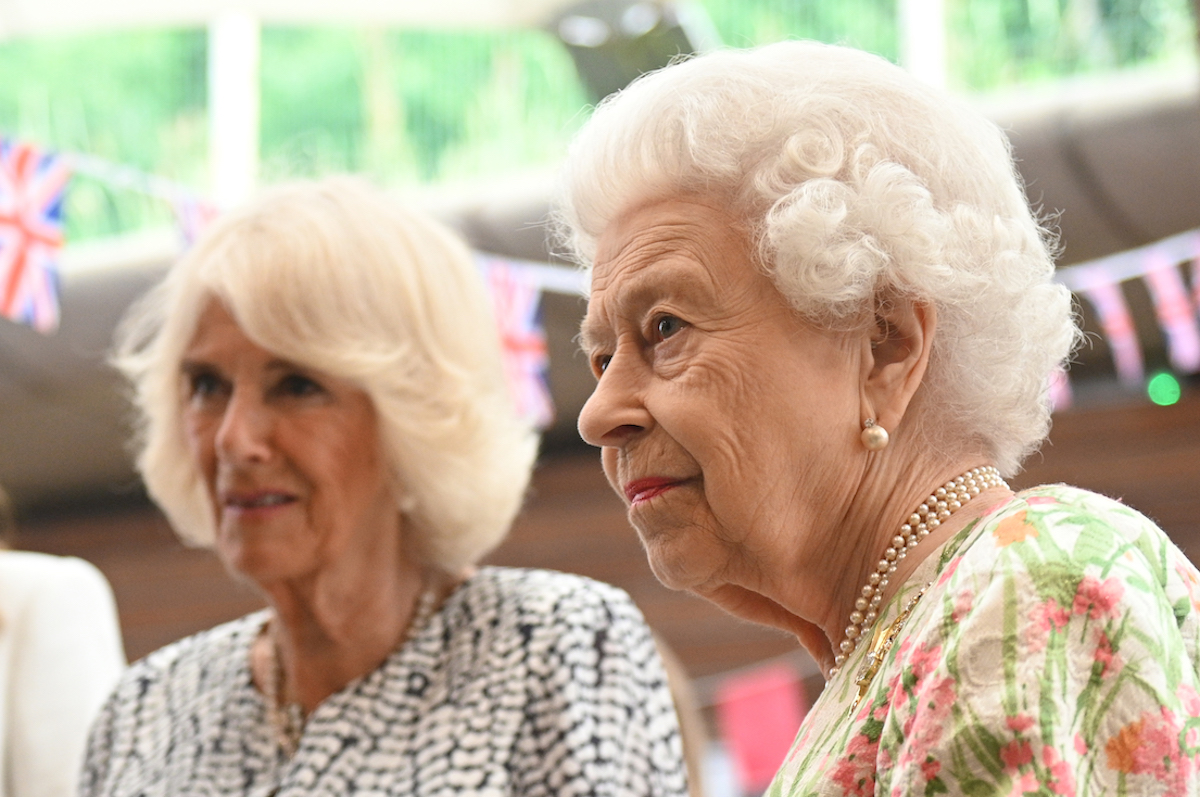 Camilla, Duchess of Cornwall and Queen Elizabeth II meet people from communities across Cornwall at an event in celebration of The Big Lunch initiative at The Eden Project during the G7 Summit on June 11, 2021 in St Austell, Cornwall, England. UK Prime Minister, Boris Johnson, hosts leaders from the USA, Japan, Germany, France, Italy and Canada at the G7 Summit.