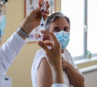 Vaccination of patients, Doctor provided a vaccine with a syringe against a new strain of virus or influenza in a modern hospital, Prevention and health care concept.