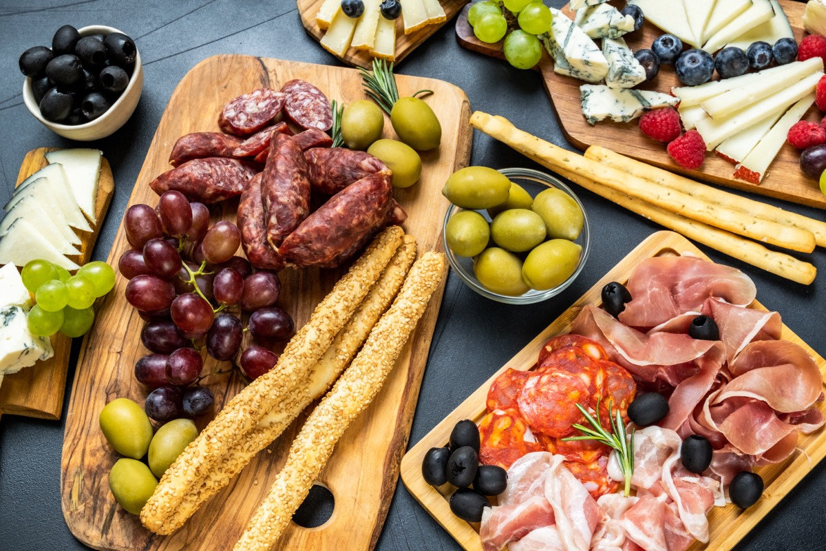 charcuterie board with sesame seed breadsticks