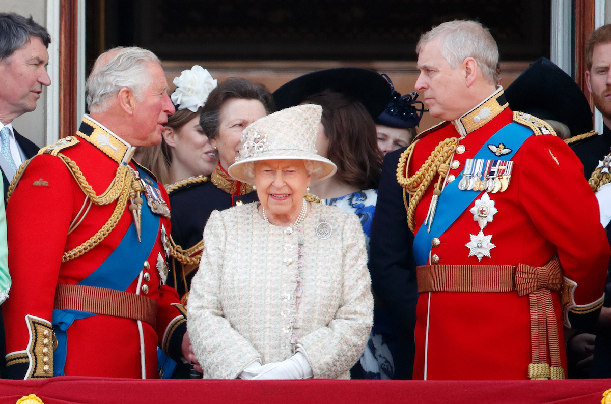 Prince Charles, Prince of Wales, Queen Elizabeth II and Prince Andrew, Duke of York watch a flypast from the balcony of Buckingham Palace during Trooping The Colour, the Queen's annual birthday parade, on June 8, 2019 in London, England.