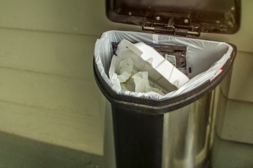 Household trash concept to throw away and be wasteful of garbage going into the landfill.