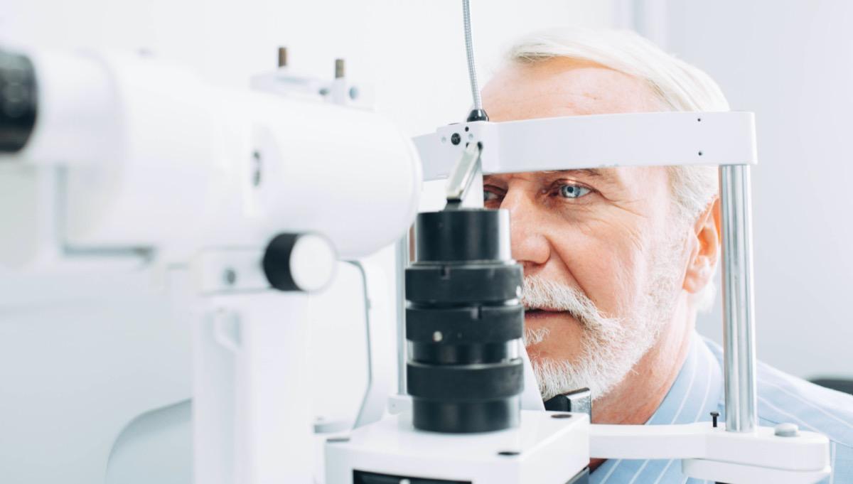 Senior man getting eye exam
