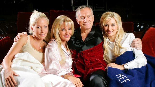 Hugh Hefner poses with Kendra Wilkinson (L) Bridget Marquardt and Holly Madison (R) before a screening of Bonnie and Clyde at the Playboy Mansion June 18, 2004 in Los Angeles, California.