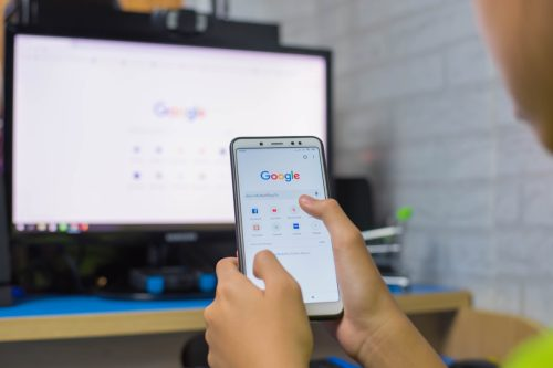 CHIANG RAI THAILAND - JUN 11 2019: Close Up to Female Typing on Google Search Engine From Smartphone. Google is the Biggest Internet Search Engine in the World.