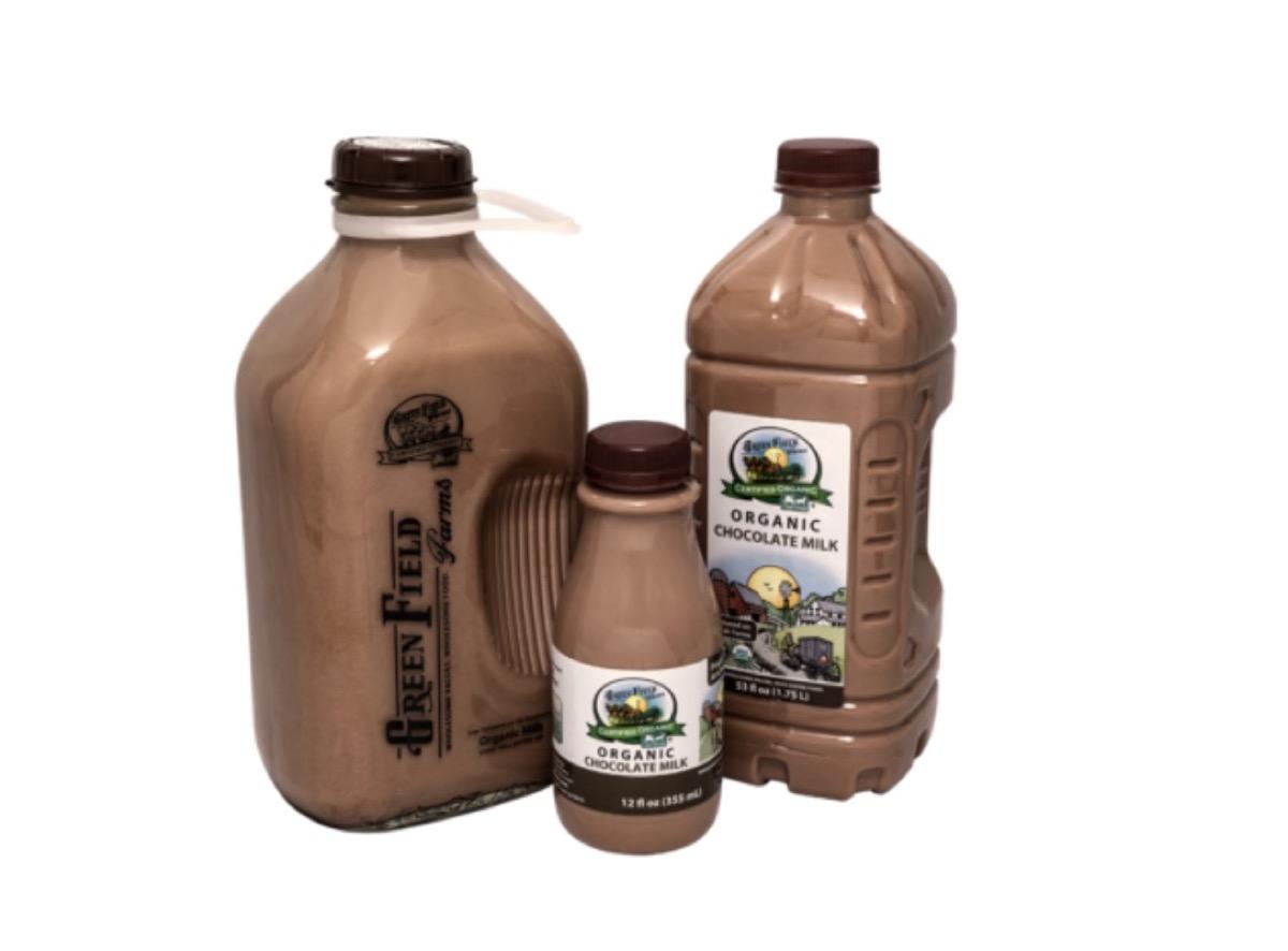 three bottles of chocolate milk against white background