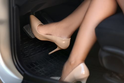 Woman wears heels while driving a car