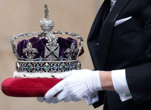 The Imperial State Crown arrives for the State Opening of Parliament at the Houses of Parliament in London on May 11, 2021, which is taking place with a reduced capacity due to Covid-19 restrictions. - The State Opening of Parliament is where Queen Elizabeth II performs her ceremonial duty of informing parliament about the government's agenda for the coming year in a Queen's Speech.