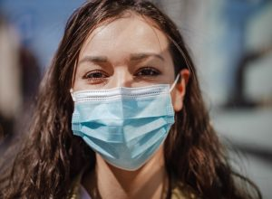 Photo of a young woman with protective face mask