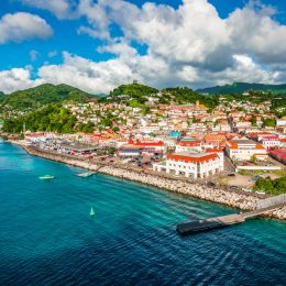 Bright and colorful image with buildings at the port of Grenada in the Caribbean.