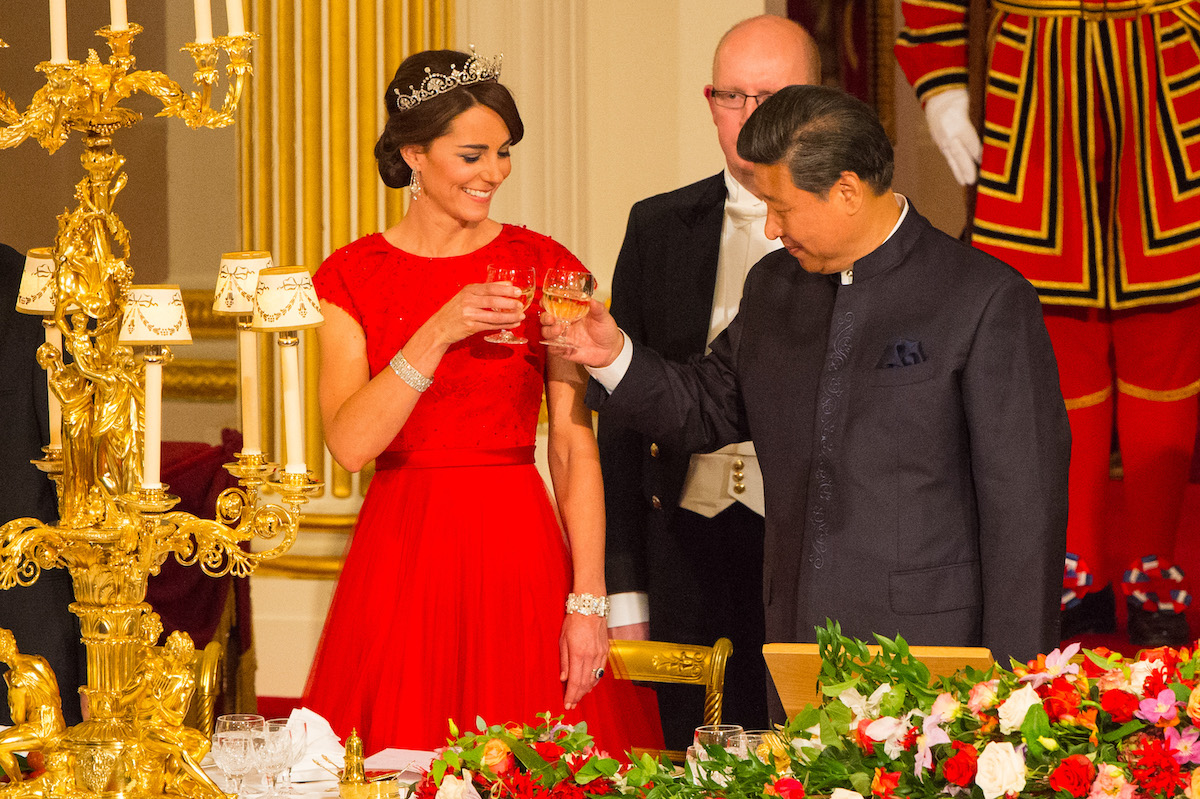 Chinese President Xi Jinping with the Duchess of Cambridge (left) and Queen Elizabeth II at a state banquet at Buckingham Palace, London, during the first day of his state visit to the UK.
