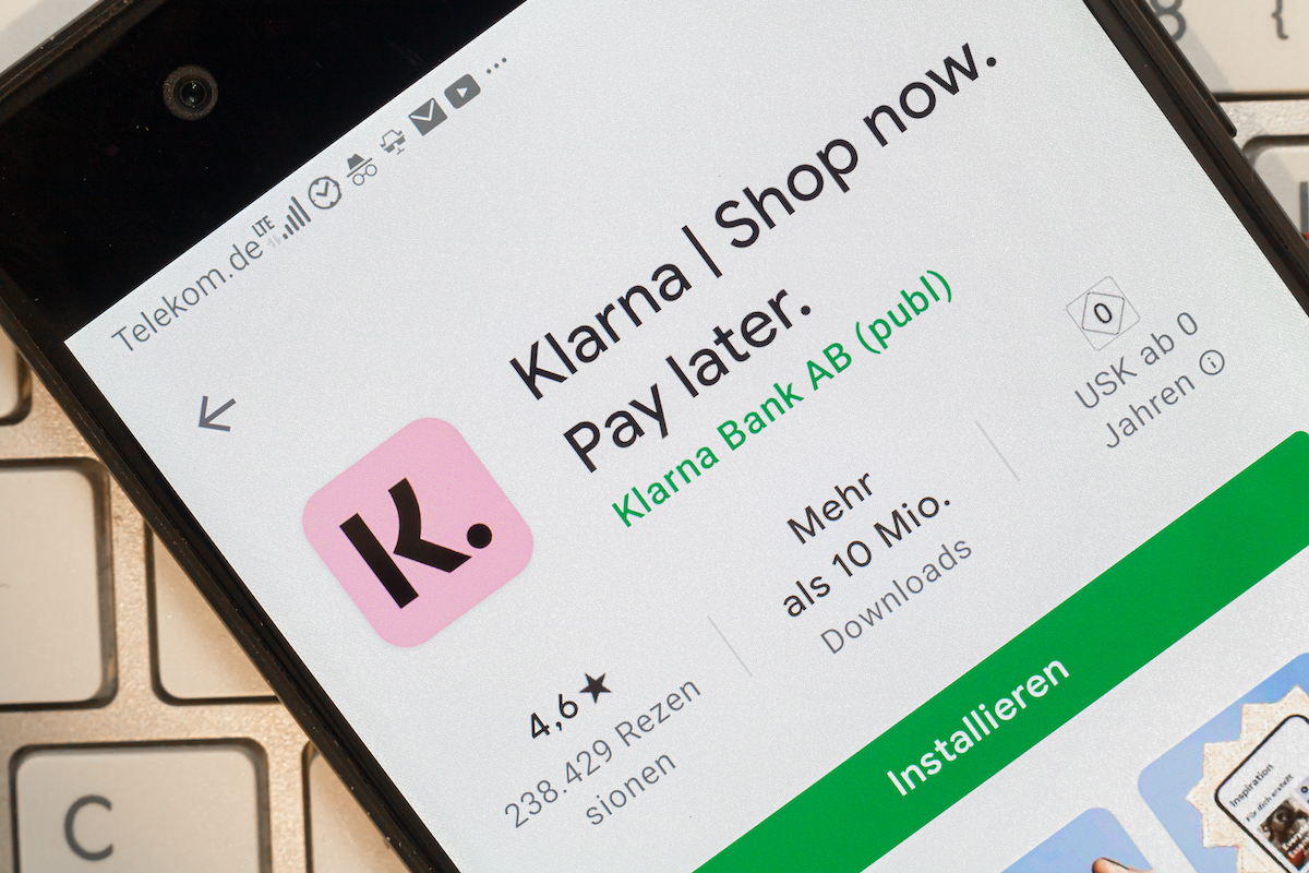 app icon of the klarna app in an app store on phone screen top view