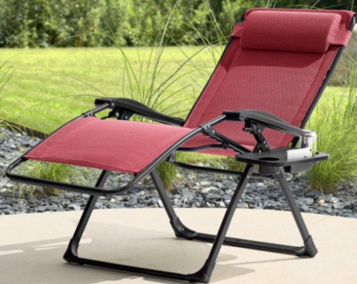 burgundy kohl's chair with black frame sitting outdoors