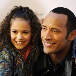 """Dwayne Johnson, aka """"The Rock"""" and Madison Pettis pose for photographers at a photo call for the film """"The Game Plan"""" in Berlin on March 5, 2008."""