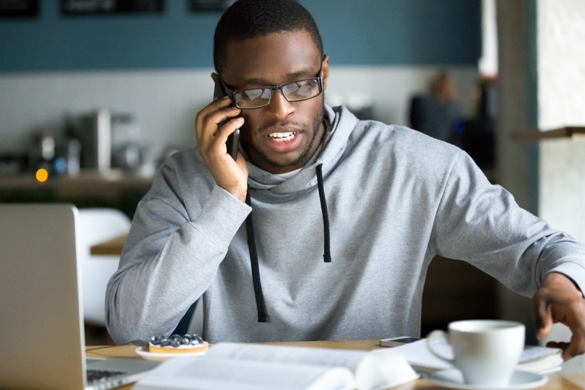 young man in glasses making a call on his phone
