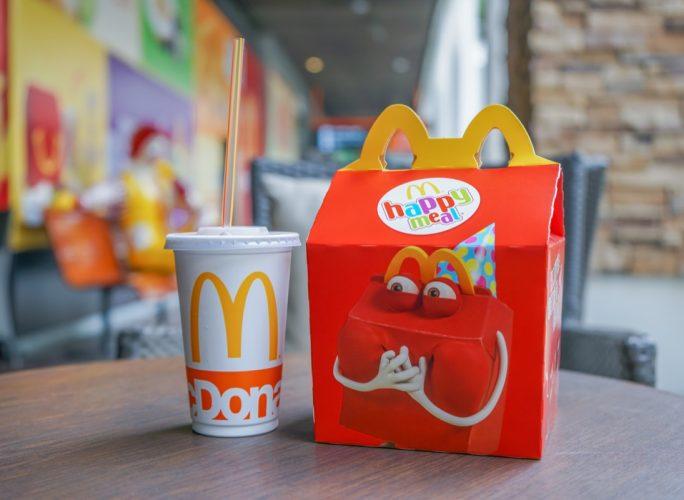 BANGKOK - OCTOBER 10 : Happy meal set ,in soft focus, with blurred Ronald Mcdonald at McDonald's restaurant on October 10, 2017 in Bangkok, Thailand