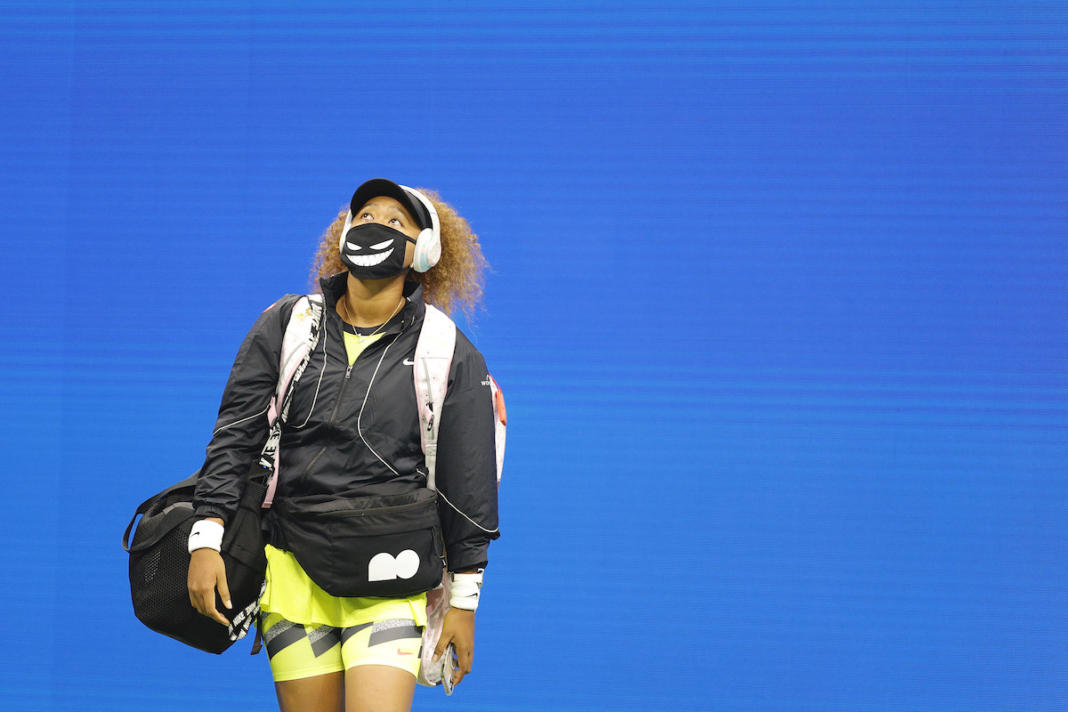 Naomi Osaka of Japan walks out onto the court to warm-up against Marie Bouzkova of Czech Republic during their women's singles first round match on Day One of the 2021 US Open at the Billie Jean King National Tennis Center on August 30, 2021 in the Flushing neighborhood of the Queens borough of New York City.