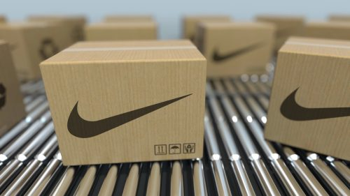 Carton boxes with nike logo move on roller conveyor. realistic 3D rendering