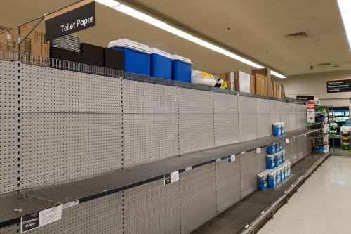 Gold Coast, Australia - March 8, 2020: Coles supermarket empty toilet paper shelves amid coronavirus fears, shoppers panic buying and stockpiling toilet paper as Australia prepares for a pandemic.