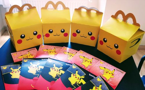 BUDAPEST, HUNGARY - Jun 18, 2021: Pokemon trading cards you can get with Happy Meal in McDonald's in Hungary